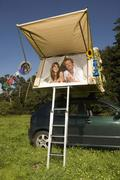 Germany, Bavaria, Young couple laying in tent - stock photo