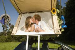 Germany, Bavaria, Young couple laying in tent Stock Photos