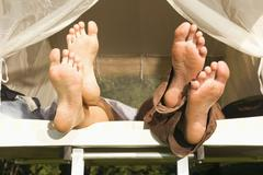 Germany, Bavaria, Feet sticking out of a tent Stock Photos