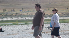 Fat people walking in desert Stock Footage