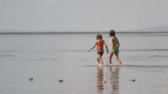 Kids playing in lake Stock Footage