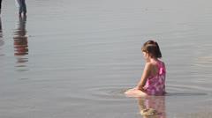 Girl playing in lake Stock Footage
