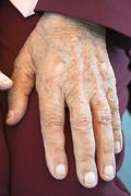 Senior woman's hand, close-up - stock photo