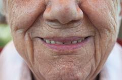 Stock Photo of Senior woman smiling, close-up