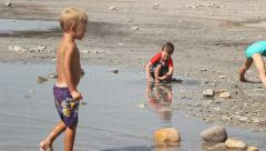 Kids playing on beach Stock Footage