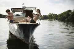 Germany, Berlin, Young couple on motor boat - stock photo