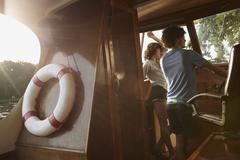Germany, Berlin, Young couple in boat cabin Stock Photos