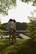 Germany, Berlin, Spree river, Young Couple embracing Stock Photos