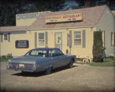 SUPER8 crossroad restaurant with 1970's Buick Stock Footage