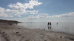 Beach walkers Stock Footage