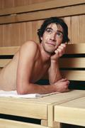 Man relaxing in sauna Stock Photos