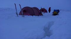 Campers in deep snow on an Arctic expedition at night. - stock footage