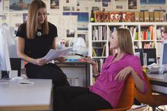 Two women in office Stock Photos