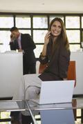 Business people in office using mobile phones Stock Photos