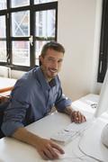 Business man in office wearing headset, portrait - stock photo