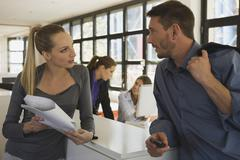 Business people in office, young woman holding documents Stock Photos