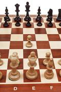 First move pawn on chessboard Stock Photos