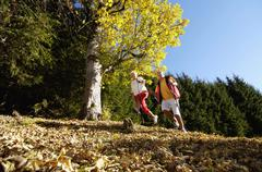senior couple nordic walking outdoors - stock photo
