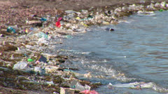 Rubbish at the seaside. - stock footage