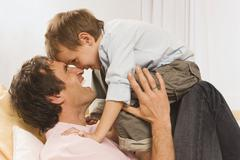 Father and son (4-5), fooling about, close up - stock photo