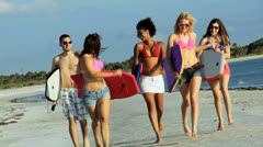 Group Teenage Vacation Friends Carrying Body Boards Beach Stock Footage