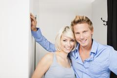 Young couple in changing room, portrait Stock Photos
