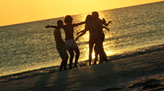 Young College Friends Enjoying Weekend Break Beach Sunset Stock Footage