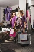 Friends going window shopping Stock Photos