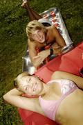 teenage couple on air bed, portrait, elevated view - stock photo