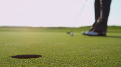 Close Up Golfer Holing Ball Stock Footage