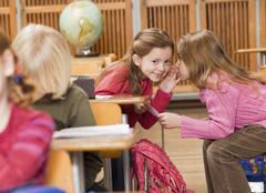 girls talking in class - stock photo