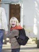 Stock Photo of mother bringing boy to school