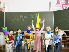 Pupils holding schoolcone Stock Photos