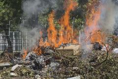 Burning garbage dump Stock Photos