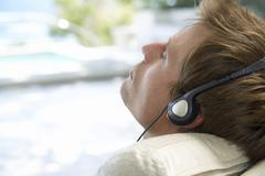 Man wearingbheadphones, relaxing Stock Photos