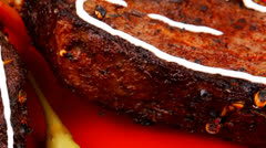 Served entree: ribs on red plate Stock Footage