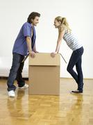 Stock Photo of couple leaning on box, face to face