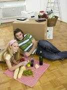 Couple having break in new flat Stock Photos