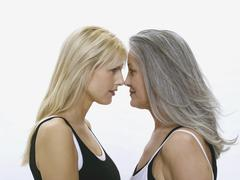 Mother and daughter, face to face Stock Photos