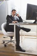 Business man sitting at desk Stock Photos