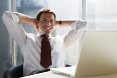 Business man relaxing arms behind head Stock Photos