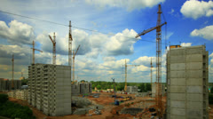 Cranes working on construction site, time-lapse. Stock Footage
