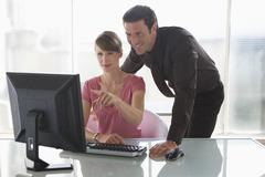business woman and man working on computer, teamwork - stock photo