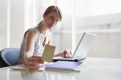 woman holding card - stock photo