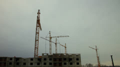 Construction site, cranes working, time-lapse. Stock Footage