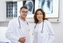 Female doctor and male doctor Stock Photos