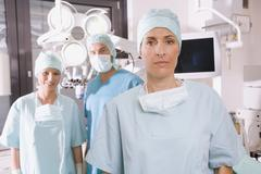 surgery team in operating room - stock photo