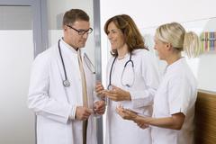 Doctors talking with nurse Stock Photos