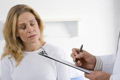 female patient and doctor - stock photo