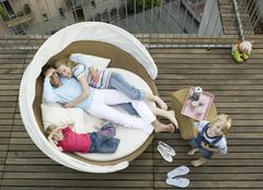 familiy on sofa, out doors - stock photo